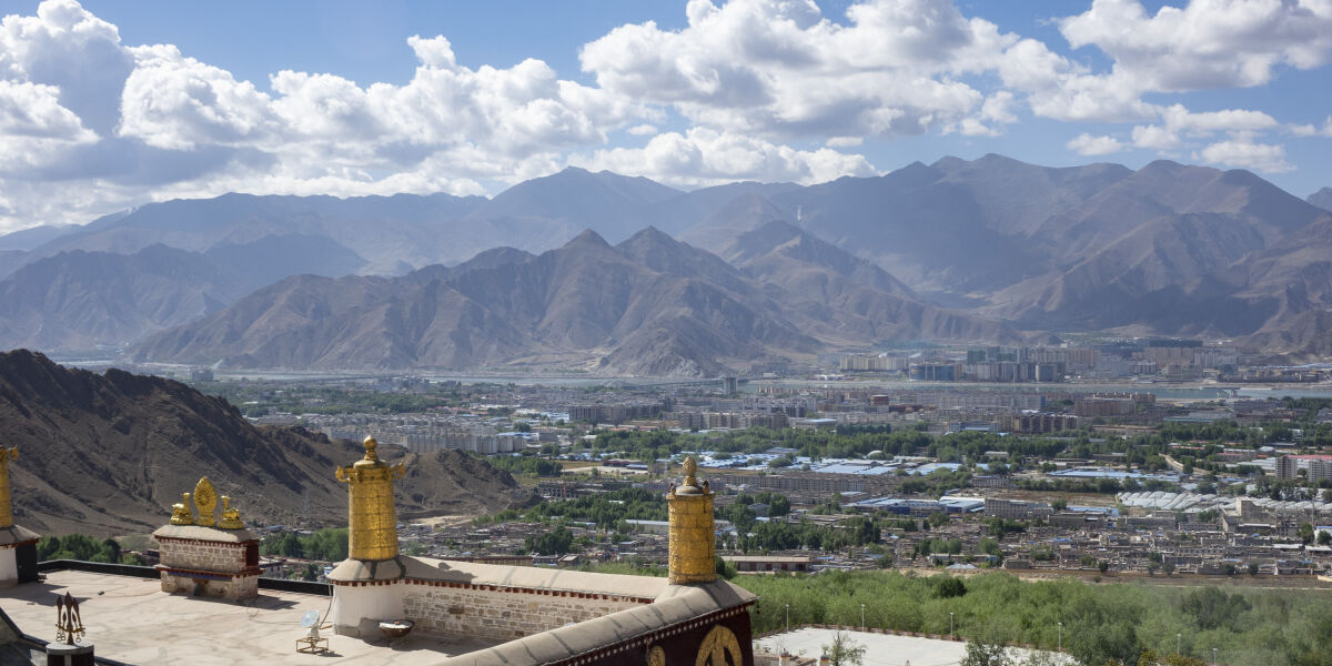 View from Ganden Palace across Lhasa, with mountains in the distance