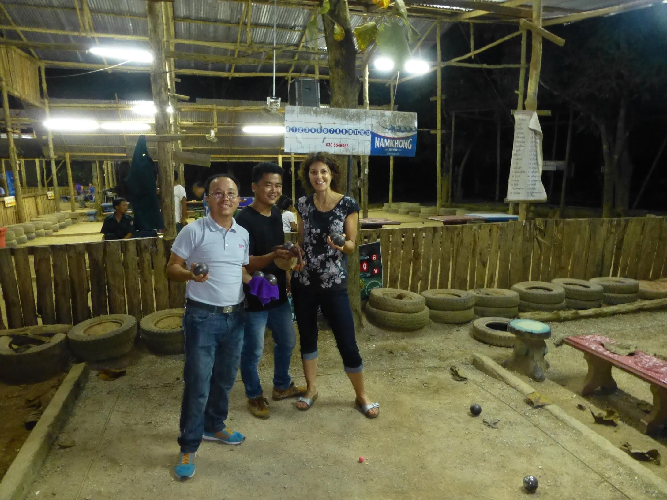 Gemma playing petanque in Laos