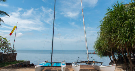 Sandy beach with boats in Kep, Cambodia