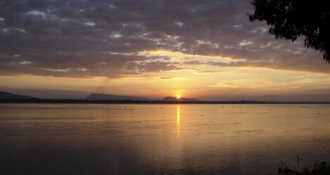Sun setting over the sea in Laos