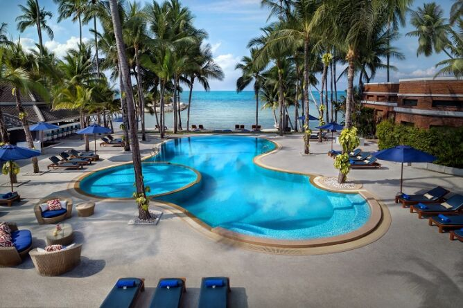Outdoor pool next to the beach