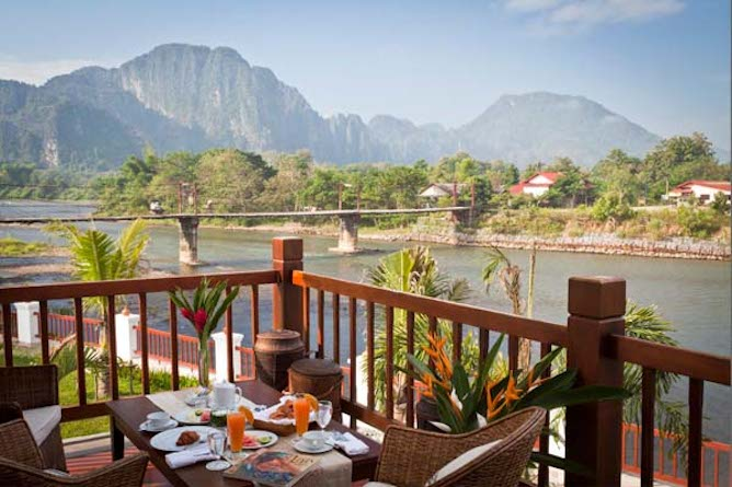 The Riverside suite private balcony with stunning views across the river and to the mountains beyond