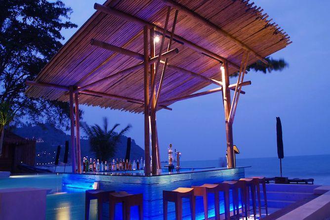 Swim-up pool bar at dusk