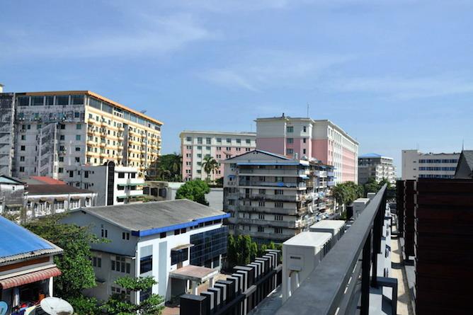 The hotel overlooks the Yaw Mingyi Street flower market