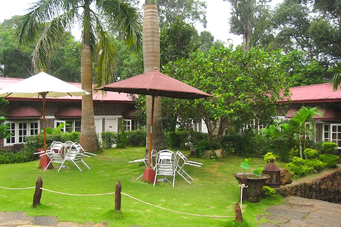 Enjoy a coffee in the well kept gardens
