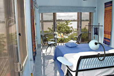 Double bedroom with views over the Mekong River