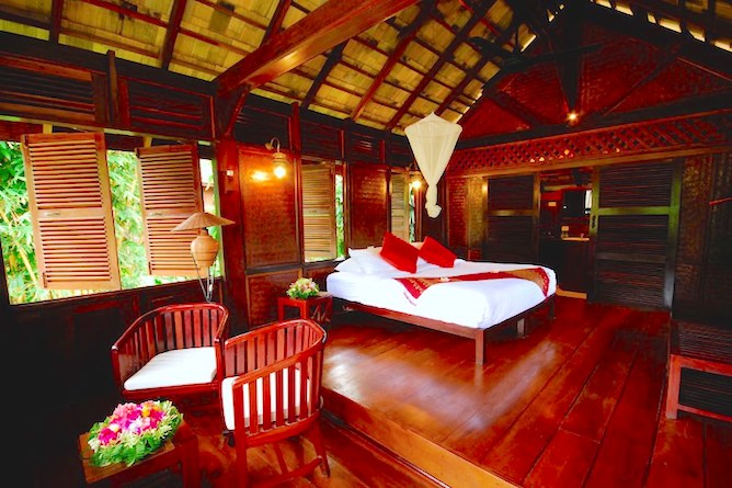 The rooms are furnished in a traditional Lao-style