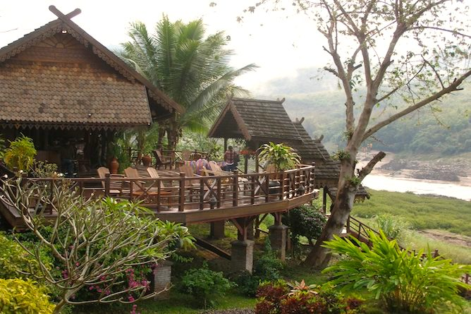 The Riverbank restaurant overlooking the Mekong River, is reached easily by wooden walkways from the guest lodges & bungalows