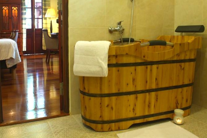 A traditional hot tub in the bathroom