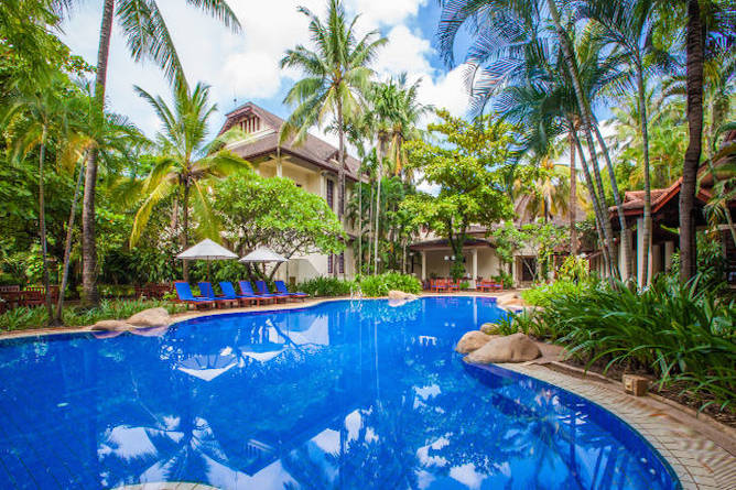 The pool is in a magnificent setting flanked by tropical palms, coconut trees and native plants